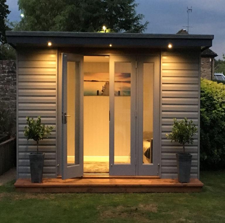 garden summerhouse at night david matthews carpentry and joinery basingstoke